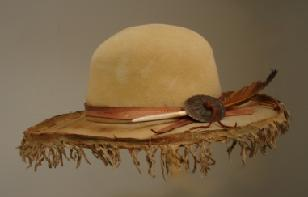 Furfelt, leather tooling, golden feather